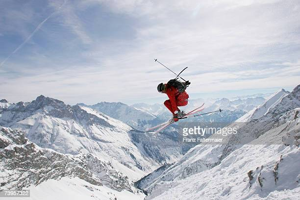 germany, damkar, person jumping ski, side view - skifahren stock-fotos und bilder
