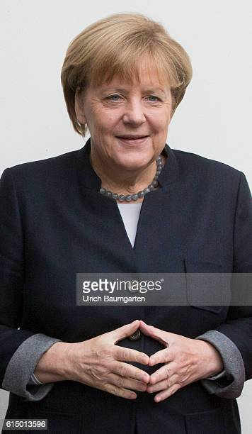 Germany Day of the Young Union in Paderborn Federal ChancellorAngela Merkel and the rhombus