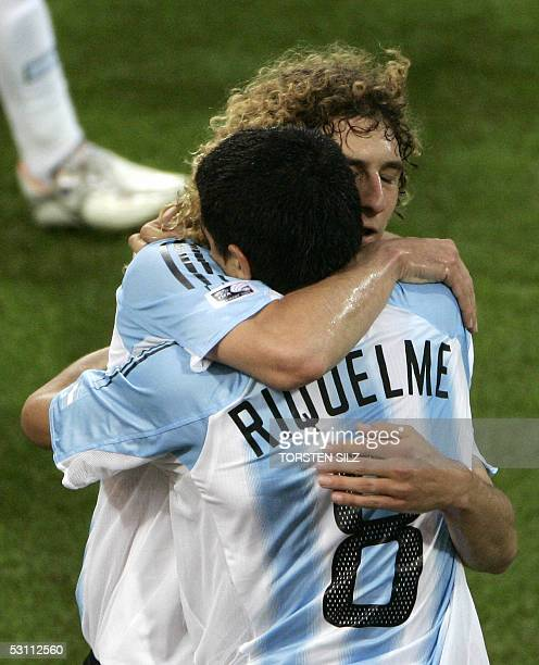 defender Fabricio Coloccini congratulates midfielder Juan Riquelme after he scored an equalizer during the 2005 FIFA Confederations Cup football...