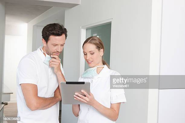 Germany, Dentist standing with clipboard