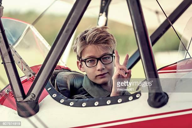 Germany, Dierdorf, Boy sitting in biplane