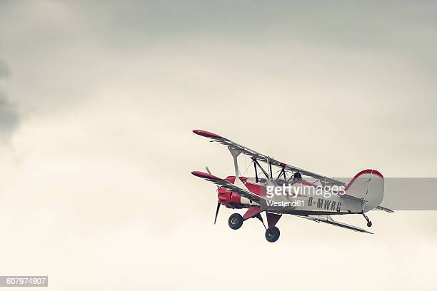Germany, Dierdorf, Vintage biplane in the air