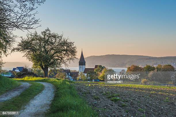 Germany, Dingelsdorf, View to St. Nicholas Church in the evening