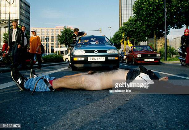 DEU Germany Dortmund 1996 DortmundCity BVBFans celebrating the championship a drunk lying nakedly in front of the car parade
