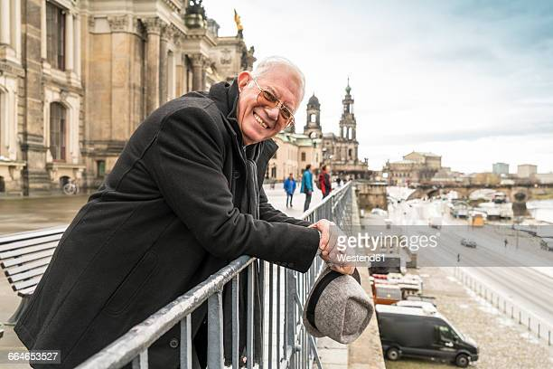 Germany, Dresden, happy senior man standing on Bruehl's Terrace
