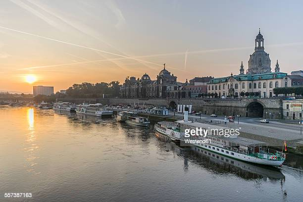 Germany, Dresden, view to city with Elbe River in the foreground at sunrise