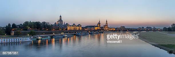Germany, Dresden, view to lighted city with Elbe River in the foreground in the evening