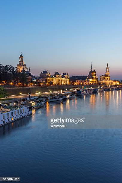 germany, dresden, view to lighted old city with elbe river in the foreground in the evening - エルベ川 ストックフォトと画像
