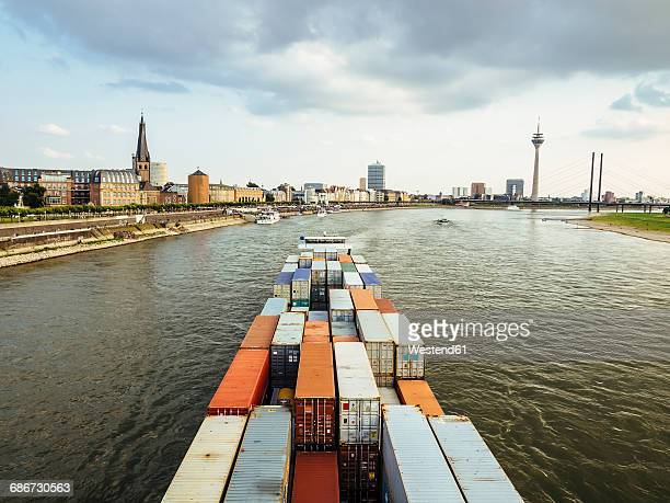 Germany, Duesseldorf, cargo ship transporting containers at Rhine River