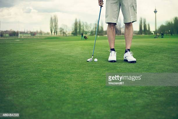 germany, duesseldorf, man golfing - teeing off stock pictures, royalty-free photos & images