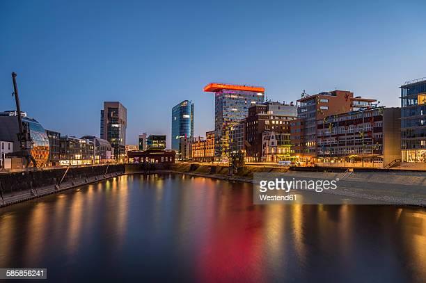 germany, duesseldorf, media harbour, high-rise building colorium, blue hour - medienhafen stock-fotos und bilder