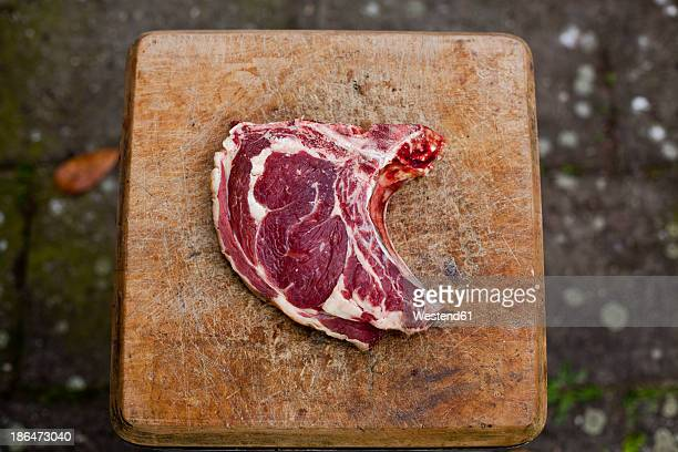 Germany, Duesseldorf, Raw beef on wood block