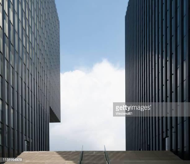 germany, duesseldorf, two facades at media harbour - medienhafen stock-fotos und bilder
