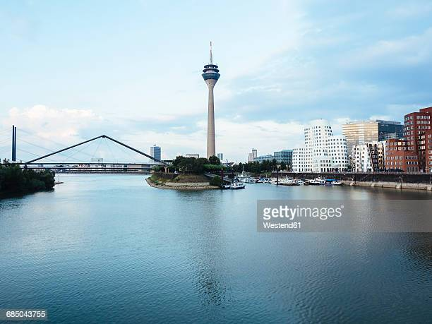 germany, duesseldorf, view to rhine tower and new zollhof with media harbour in the foreground - north rhine westphalia stock pictures, royalty-free photos & images
