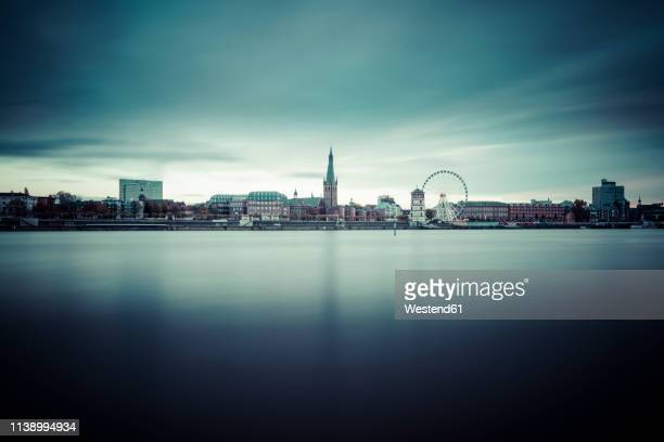 germany, duesseldorf, view to the old town with rhine river in the foreground - düsseldorf stock pictures, royalty-free photos & images