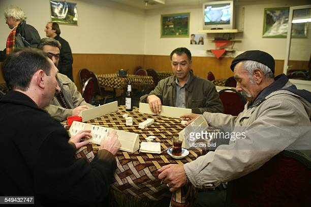 Germany, Duisburg: Marxloh; An Alevi club in a cafe where the men spend their time playing games like Okey or Tavla.