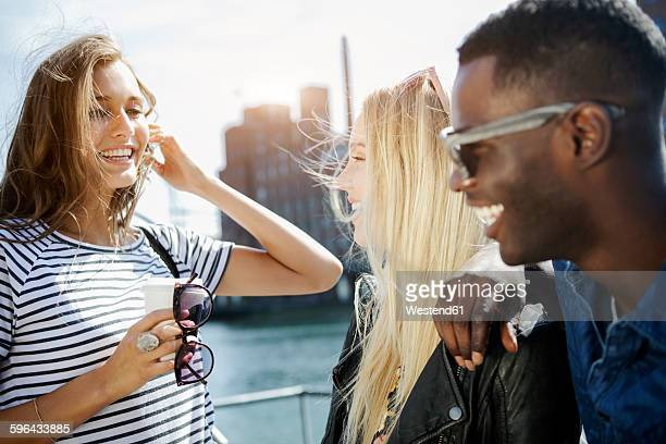 germany, duisburg, three young people having fun at media harbour - duisburg imagens e fotografias de stock