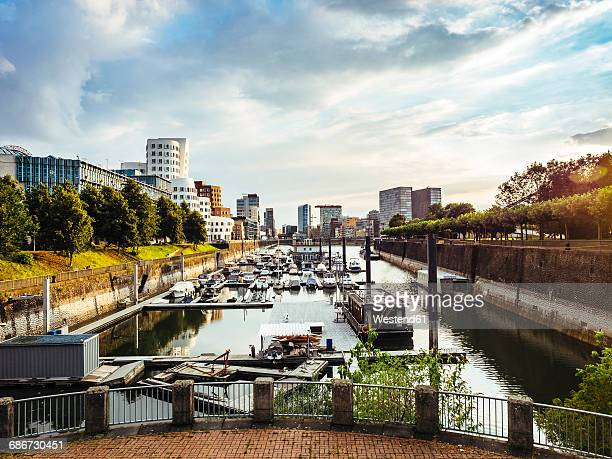 Germany, Dusseldorf, view to Media Harbour with city harbour in the foreground
