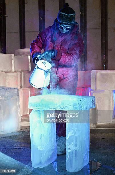 Dutch actress Daphne van Tongeren spills hot water on a block of ice during a rehearsal of the play Eismitte by Dutch director JensErwin Siemssen...
