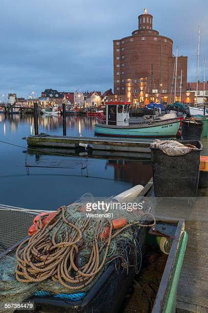 Germany, Eckernfoerde, fishing boats in harbor and silo