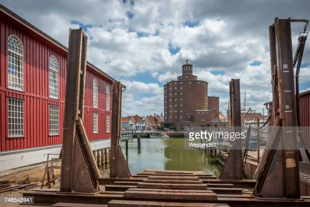 Germany, Eckernfoerde, view from harbor above a shipyard towards silo