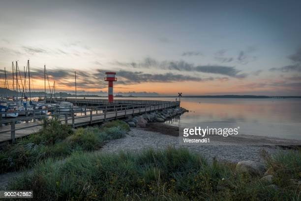 Germany, Eckernfoerde, view to Baltic sea with new light house at morning twilight