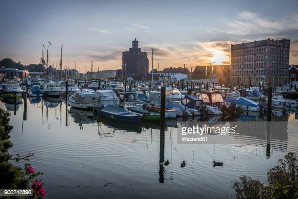 Germany, Eckernfoerde, view to old silo and harbour at morning twilight