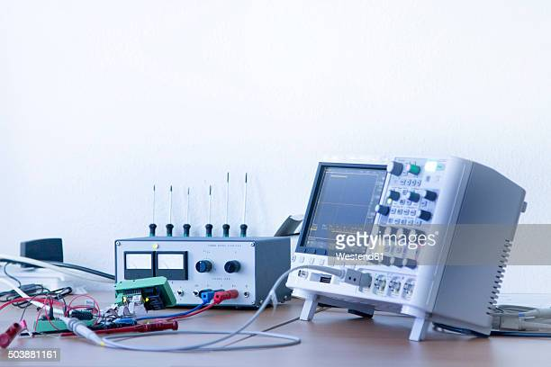 germany, electronic instruments of measurement in workshop - oscilloscope stock pictures, royalty-free photos & images