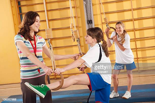 germany, emmering, woman training girls - pe teacher stock photos and pictures
