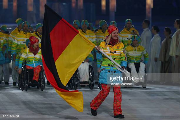Germany enter the arena lead by flag bearer Andrea Rothfuss during the Opening Ceremony of the Sochi 2014 Paralympic Winter Games at Fisht Olympic...