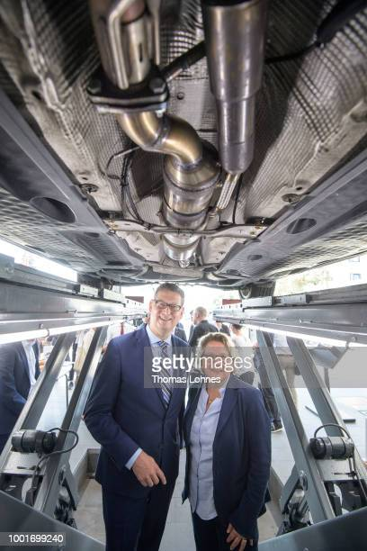 Technician Juergen Krivan holds a Diesel particel filter for the presentation while he stand under a VW Passat model with the new Diesel partical...