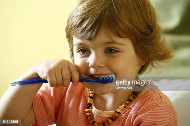 DEU Germany Essen baby brushing his teeth girl