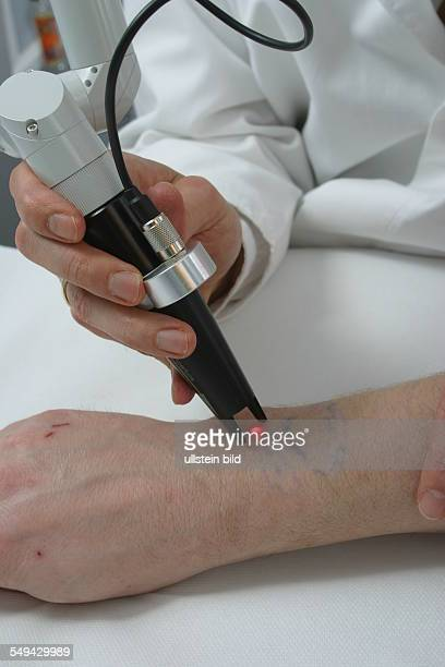 DEU Germany Essen medicine physicist and nonmedical practitioner Holger May manager of the Laser Forum Essen A patient during a laser treatment...