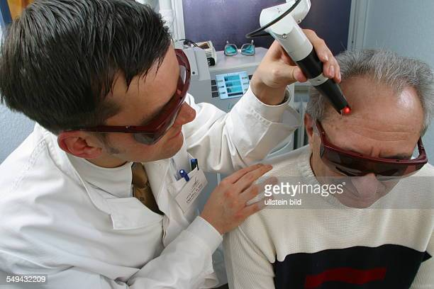 DEU Germany Essen medicine physicist and nonmedical practitioner Holger May manager of the Laser Forum Essen A patient during a laser treatment age...
