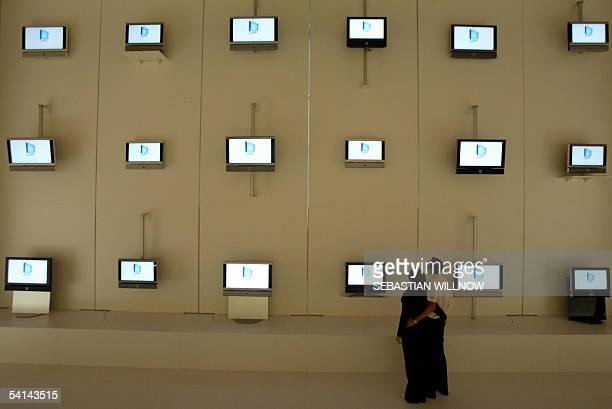 Fair visitors watch at tv screens on the fair grounds of the Consumer Electronics Fair IFA during the fair's opening day on 02 September 2005 in...