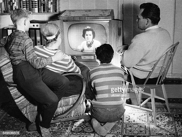 family watching TV in the fifties