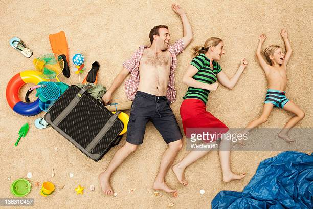 Germany, Family with toys and baggage at beach