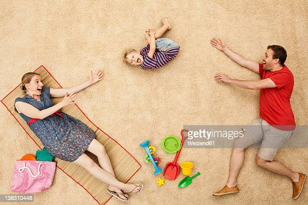 Germany, Family with toys at beach