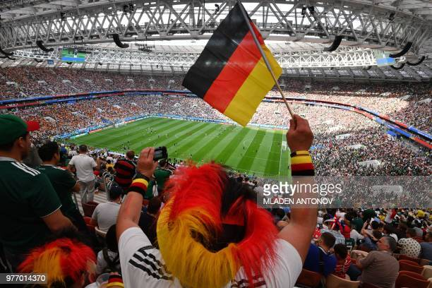 A Germany fan cheers before the Russia 2018 World Cup Group F football match between Germany and Mexico at the Luzhniki Stadium in Moscow on June 17...