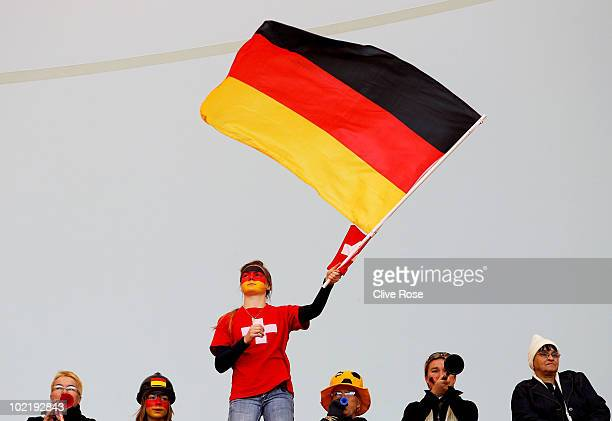 Germany fan waves the national flag ahead of the 2010 FIFA World Cup South Africa Group D match between Germany and Serbia at Nelson Mandela Bay...