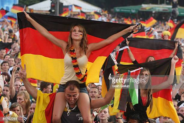 Germany fans celebrate at a public viewing at the Fan Mile in front of the Brandenburg Gate moments before the start of the UEFA EURO 2008 final...