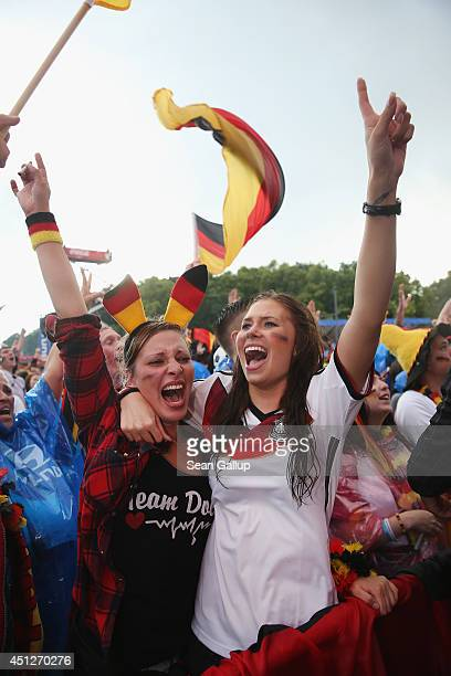 Germany fans celebrate Germany's 10 victory over the USA in their world World Cup match at the Hyundai Fan Park public viewing in front of the...