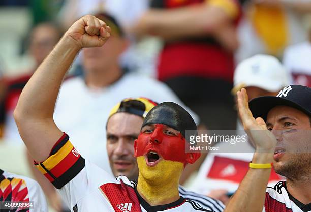 Germany fans enjoy the atmopshere prior to the 2014 FIFA World Cup Brazil Group G match between Germany and Ghana at Castelao on June 21 2014 in...