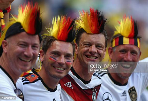 Germany fans enjoy the atmosphere during the 2014 FIFA World Cup Brazil Group G match between Germany and Ghana at Castelao on June 21 2014 in...
