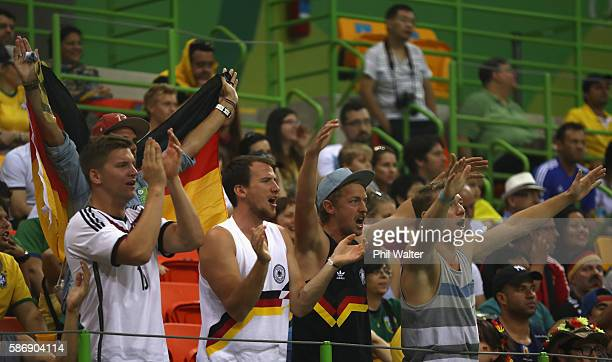 Germany fans enjoy the atmosphere during the Men's Preliminary Group B match between Sweden and Germany at on Day 2 of the Rio 2016 Olympic Games at...