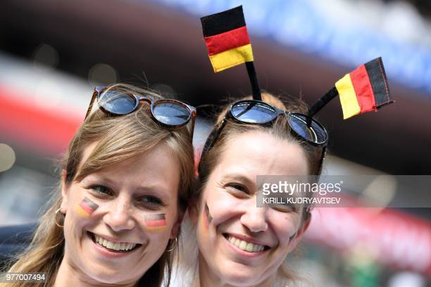 Germany fans pose before the Russia 2018 World Cup Group F football match between Germany and Mexico at the Luzhniki Stadium in Moscow on June 17...