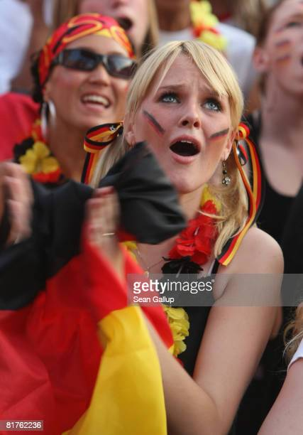 Germany fans react to play at a public viewing at the Fan Mile in front of the Brandenburg Gate while watchingf the UEFA EURO 2008 final match...