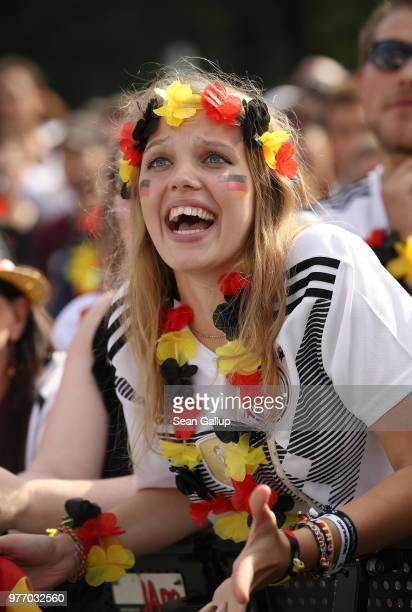 Germany fans react to play at the Fanmeile public viewing area during the Germany vs. Mexico 2018 FIFA World Cup match on June 17, 2018 in Berlin,...