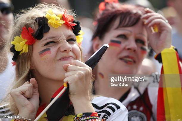 Germany fans react to play at the Fanmeile public viewing area during the Germany vs Mexico 2018 FIFA World Cup match on June 17 2018 in Berlin...