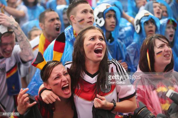 Germany fans react to play while watching the GermanyUSA World Cup match at the Hyundai Fan Park public viewing in front of the Brandenburg Gate in...